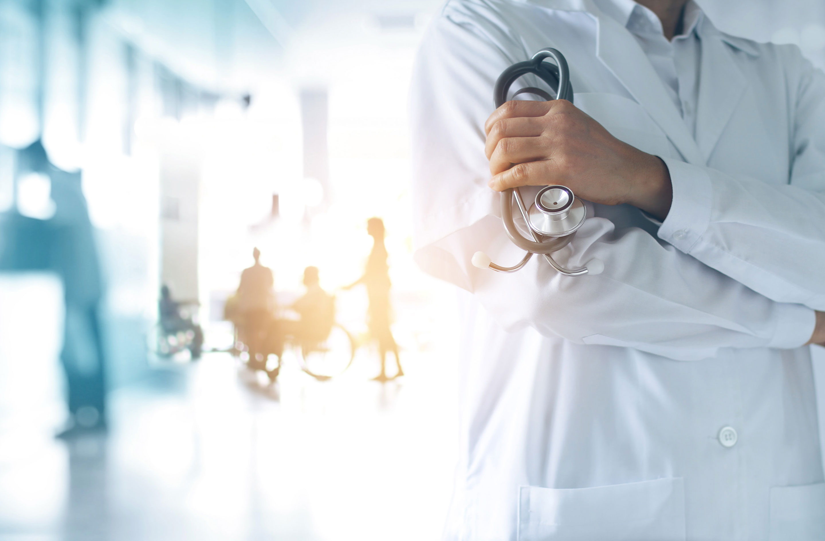 Doctor with crossed arms and stethoscope