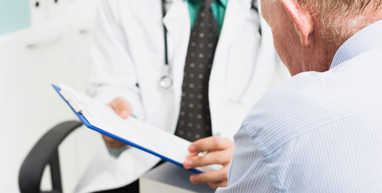 Doctor talking to patient - Urology Group, PA